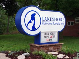 sign with base and landscaping