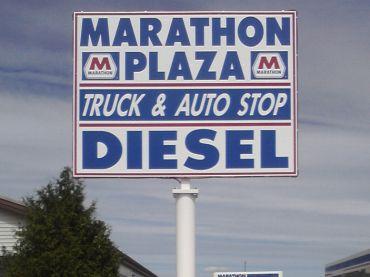 large panel sign on pole